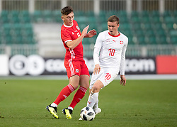 NEWPORT, WALES - Tuesday, October 16, 2018: Wales' Thomas Harris in action with Switzerland's Michel Aebischer during the UEFA Under-21 Championship Italy 2019 Qualifying Group B match between Wales and Switzerland at Rodney Parade. (Pic by Laura Malkin/Propaganda)
