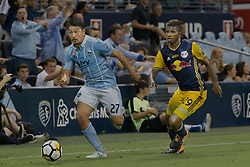 September 20, 2017 - Kansas City, Kansas, U.S - Sporting KC midfielder Roger Espinoza #27 (l) takes the offense against NY Red Bulls defender Fidel Escobar #29 (r) during the second half of the game. Sporting KC will win the 2017 Lamar Hunt Open Cup championship with a score of 2-1 over the New York Red Bulls. (Credit Image: © Serena S.Y. Hsu via ZUMA Wire)