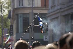 © Licensed to London News Pictures. 15/05/2021. London, UK. Free Palestine protesters burn Israeli flag in Kensington, central London near Israeli Embassy. Photo credit: Marcin Nowak/LNP