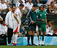 Photo: Glyn Thomas.<br />Tunisia v Saudi Arabia. Group H, FIFA World Cup 2006. 14/06/2006.<br /> Tunisia's Karim Essediri (L) prepares to come on as an 82nd minute substitute.