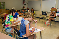 """Mr. Eckhardt's Advisory class works on a """"personality inventory"""" exercise during Freshman Jump Start at Gilford High School Wednesday morning.  (Karen Bobotas/for the Laconia Daily Sun)"""