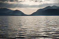 Reflection of sunlight in the waters of Loch Linnhe with mountains in background, Lochaber, Scotland