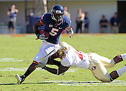 Oct 2, 2010; Charlottesville, VA, USA; Virginia Cavaliers running back Torrey Mack (5) eludes a tackle from Florida State Seminoles linebacker Jeff Luc (48) during the 2nd half of the game at Scott Stadium. Florida State won 34-14.  Photo/The Daily Progress/Andrew Shurtleff