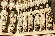 Gothic statues of an  array of saints.  Gothic Cathedral of Notre-Dame, Amiens, France