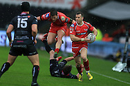 Gareth Davies of the Scarlets goes past Jeff Hassler of the Ospreys to set up the 1st half try from DTH Van Der Merwe of Scarlets. Guinness Pro12 rugby match, Ospreys v Scarlets at the Liberty Stadium in Swansea, South Wales on Saturday 26th March 2016.<br /> pic by  Andrew Orchard, Andrew Orchard sports photography.