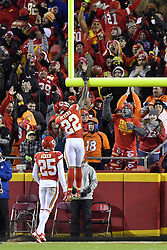 October 30, 2017 - Kansas City, MO, USA - Kansas City Chiefs cornerback Marcus Peters celebrates his fumble recovery for a touchdown in the first quarter by dunking the ball over the goalpost during Monday's football game against the Denver Broncos on Oct. 30, 2017 at Arrowhead Stadium in Kansas City, Mo. (Credit Image: © John Sleezer/TNS via ZUMA Wire)