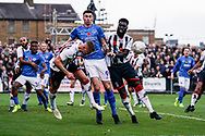 Kilgour of Maidenhead United heads the ball clear during the The FA Cup 1st round match between Maidenhead United and Portsmouth at York Road, Maidenhead, United Kingdom on 10 November 2018.