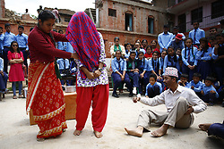 May 28, 2017 - Bhaktapur, Nepal - Nepalese artists stage an awareness drama at a school to mark Menstrual Hygiene day in Bhaktapur, Nepal on Sunday, May 28, 2017.  Menstrual Hygiene management still remains a major health and social issue in Nepal. Women are prevented to lead a normal life attending school and performing their usual daily activities during their menses.  Due to cultural beliefs women are considered impure or unclean during their menstruation.  This play reinforced the need to bring awareness to society about menstruation, promote safe and hygiene practices and fight harmful stigmas. (Credit Image: © Skanda Gautam via ZUMA Wire)