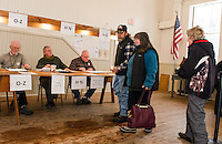 Dick LeClerc, Steve Ober and Craig Davis check in a steady stream of voters at the Sanbornton Town Hall for the NH Primary on Tuesday morning.  (Karen Bobotas/for the Laconia Daily Sun)