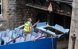 © Licensed to London News Pictures; 10/09/2020; Bristol, UK. Emergency services work to free a bus that crashed into a low bridge with a height of 13 foot six inches over Frogmore Street in Bristol City Centre. No one was hurt. It is the second crash of a bus under a low bridge that has happened today, the first one being in Winchester where several children were seriously hurt. Photo credit: Simon Chapman/LNP.