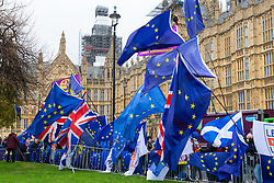 Flags fly outside the Houses of Parliament as MPs debate and vote later on Prime Minister Theresa May's Brexit deal. London, January 15 2019.