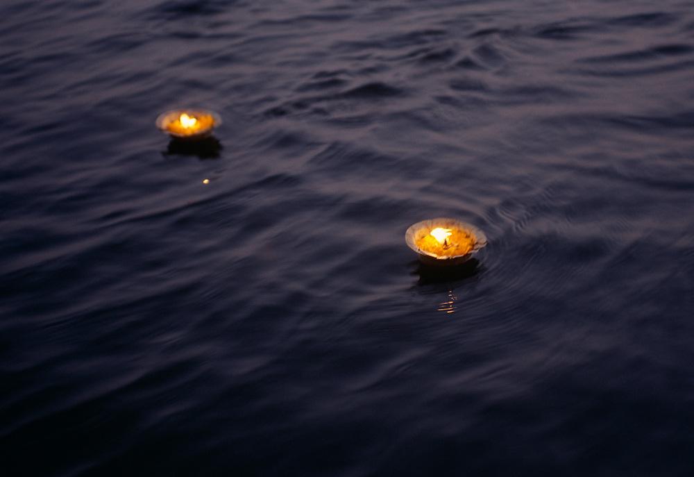 Prayer lights floating on water