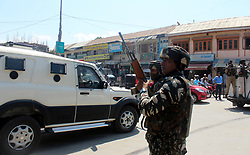 August 28, 2017 - Anantnag, Jammu And Kashmir, India - A security force personal in action after unidentified gunman shot and critically injured a policeman Assistant Sub--Inspector  in south Kashmir's Anantnag district on Monday,28 of August  2017.ASI Abdul Raseed resident of Panzat Qazigund aged 45 was shot in abdomen by unidentified persons from close range. The injured cop was shifted to Anantnag hospital where doctors referred him to SMHS hospital Srinagar where he succumbs. (Credit Image: © Aasif Shafi/Pacific Press via ZUMA Wire)