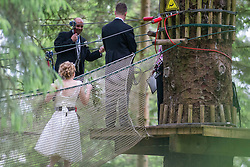 Martin Milner waiting for Colette Gregory tying the knot in the trees at Go Ape Aberfoyle.