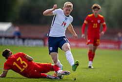 NEWPORT, WALES - Friday, September 3, 2021: England's Lewis Hall (R) is tackled by Wales' Jack Karadogan during an International Friendly Challenge match between Wales Under-18's and England Under-18's at Spytty Park. (Pic by David Rawcliffe/Propaganda)