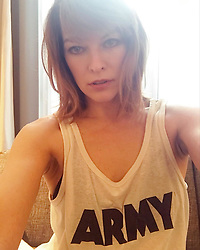 """Milla Jovovich releases a photo on Instagram with the following caption: """"Favorite shirt. Ever. God Bless all our incredible men and women in the #military. And thank you @avalonvintage and @carmen_hawk for this amazing piece! #parisdiary \ud83d\udc4a\ud83c\udffc\ud83d\udc4f\ud83c\udffc\ud83d\udc4d\ud83c\udffc\u2764\ufe0f\u2764\ufe0f\u2764\ufe0f"""". Photo Credit: Instagram *** No USA Distribution *** For Editorial Use Only *** Not to be Published in Books or Photo Books ***  Please note: Fees charged by the agency are for the agency's services only, and do not, nor are they intended to, convey to the user any ownership of Copyright or License in the material. The agency does not claim any ownership including but not limited to Copyright or License in the attached material. By publishing this material you expressly agree to indemnify and to hold the agency and its directors, shareholders and employees harmless from any loss, claims, damages, demands, expenses (including legal fees), or any causes of action or allegation against the agency arising out of or connected in any way with publication of the material."""