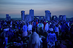 © Licensed to London News Pictures.21/06/2017. Stonehenge, Amesbury, Wiltshire, UK. Summer Solstice celebrations at Stonehenge. Revellers at dawn waiting for the sunrise on the longest day of the year. Photo credit : Simon Chapman/LNP