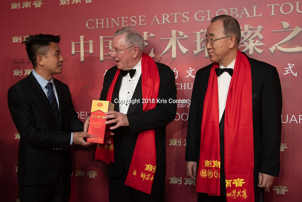 """NEW YORK- JANUARY 12:  Yu Xue of Jian Nan Chun greets Ban Ki-moon, former ,Secretary-General of the United Nations, and Malcolm Stevenson """"Steve"""" Forbes Jr. attend the Chinese Arts Global Tour Gala in the Delegates Dining Room at the United Nations Headquarters on January 12th, 2019 in New York City. (Photo by Kris Connor/Smokeless Fire Group)"""