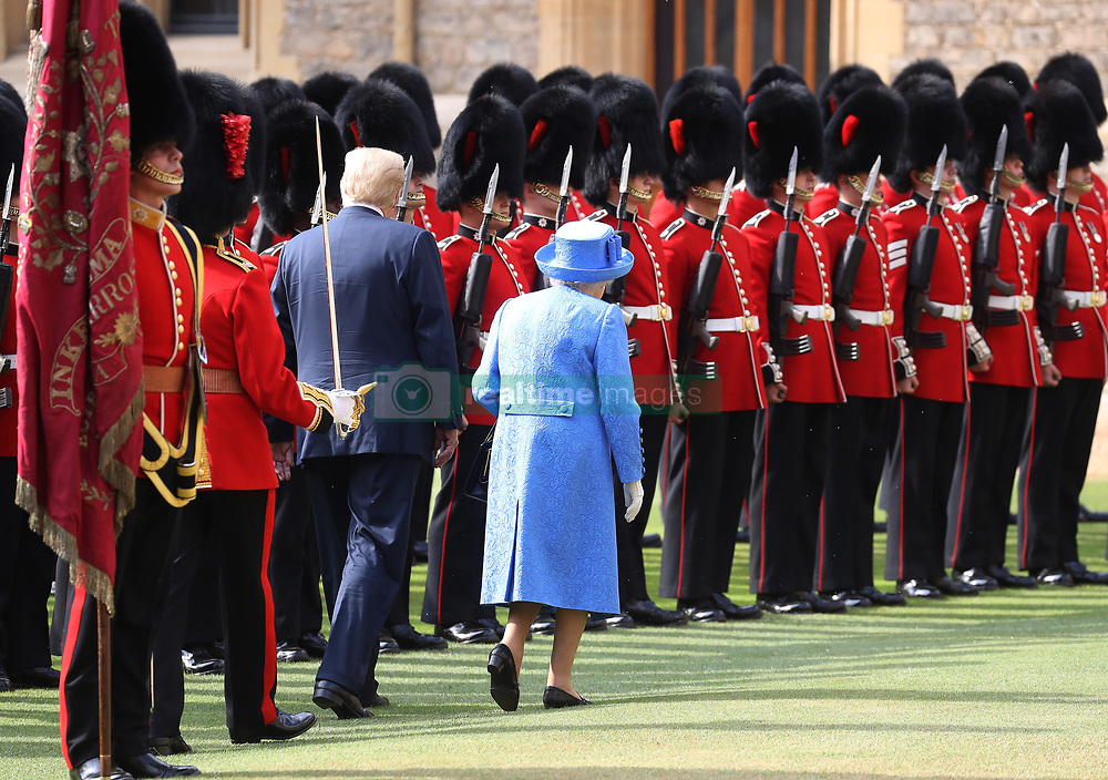 The Queen and US President Donald Trump inspect the Guard of Honour before watching the military march past at Windsor Castle, Windsor, Berkshire, UK, on the 13th July 2018. Picture by Chris Jackson/WPA-Pool. 13 Jul 2018 Pictured: Donald Trump, Queen, Queen Elizabeth. Photo credit: MEGA TheMegaAgency.com +1 888 505 6342