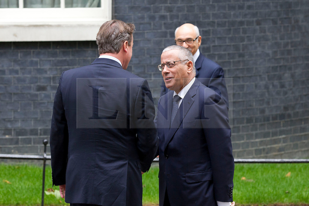 © Licensed to London News Pictures. 17/09/2013. London, UK. The British Prime Minister David Cameron shakes hands with the Libyan Prime Minister Ali Zeidan on Downing Street in London today (17/09/2013) as the pair meet for talks. Photo credit: Matt Cetti-Roberts/LNP