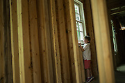 SEPTEMBER 13, 2016: Children explore the job site of a new home construction.