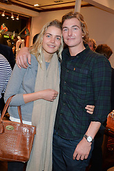 ARNAUD HAINES and ANNA FROGNER at a pre christmas party & shopping evening at Patrick Mavros, 104-106 Fulham Road, London on 26th November 2014.
