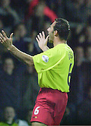Watford, England. <br /> Vicarage Road.<br /> Football - Worthington Cup 9/10/01<br /> Watford v Bradford:<br /> Watford's Ramon Vega look's to the home supporter after scoring the third goal.   [Mandatory Credit:Peter SPURRIER/Intersport Images]