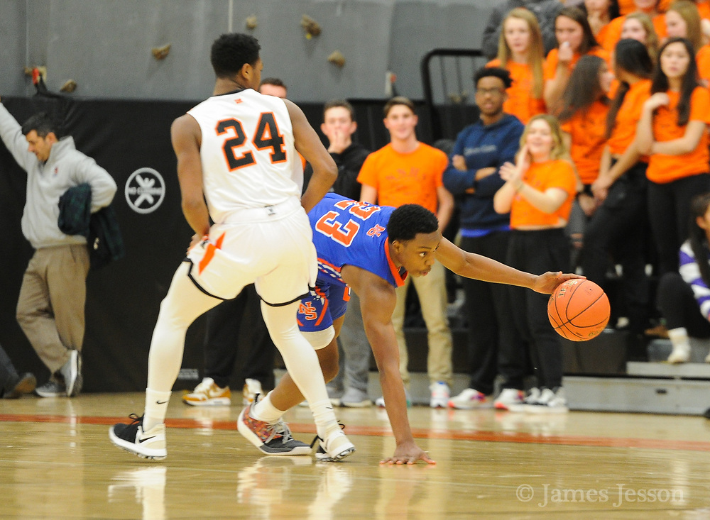 Newton South junior Njavan Stewart-Okiwe tries to hold on to a dribble around Newton North senior Kyle Ray-Canada during the game at Newton North, Dec. 27, 2018.   [Wicked Local Photo/James Jesson]