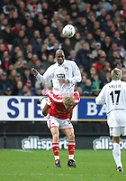 Photo: Jo Caird<br /> Charlton v Leeds<br /> <br /> Barclaycard Premiership 2003<br /> 29/11/2003.<br /> <br /> jamal campbell-ryce headers on top of Mathias Svensson