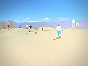Tourists at the Mesquite Dunes in Death Valley National Park