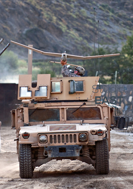 US Army Specialist Dawes prepares to launch a Puma UAV (Unmanned Aerial Vehicle) from a Humvee at Forward Operating Base Blessing in Nangalam, Kunar Province, eastern Afghanistan. 3 October 2009. UAVs are used extensively in the mountainous region of eastern Afghanistan and Pakistan in reconnaissance and interdiction roles with measurable success against Taliban targets.