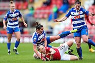 Manchester United midfielder Leah Galton (11) makes a tackle during the FA Women's Super League match between Manchester United Women and Reading LFC at Leigh Sports Village, Leigh, United Kingdom on 7 February 2021.