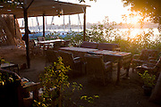 Empty tourist riverside cafe and restaurant furniture on overlooking the Nile in the village of Gezirat on the West Bank of Luxor, Nile Valley, Egypt. According to the country's Ministry of Tourism, European visitors to Egypt  is down by up to 80% in 2016 after the suspension of flights after the downing of the Russian airliner in Oct 2015. Euro-tourism accounts for 27% of the total flow and in total, tourism accounts for 11.3% of Egypt's GDP.