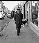 Small Jer O'Leary walking on Main Street, Killarney in 1972<br /> Picture by Donal MacMonagle<br /> <br /> www.macmonagle.com<br /> macmonagle photo archive