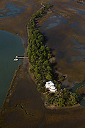 Aerial view of a remote home built on a small island in the marsh Charleston, SC.