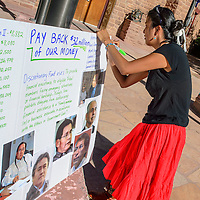 072215  Adron Gardner/Independent<br /> <br /> Colleen Cooley puts the finishing touches on a protest sign highlighting discretionary fun misuse by tribal council delegates at the Navajo Nation Tribal Council Chambers in Window Rock Wednesday.
