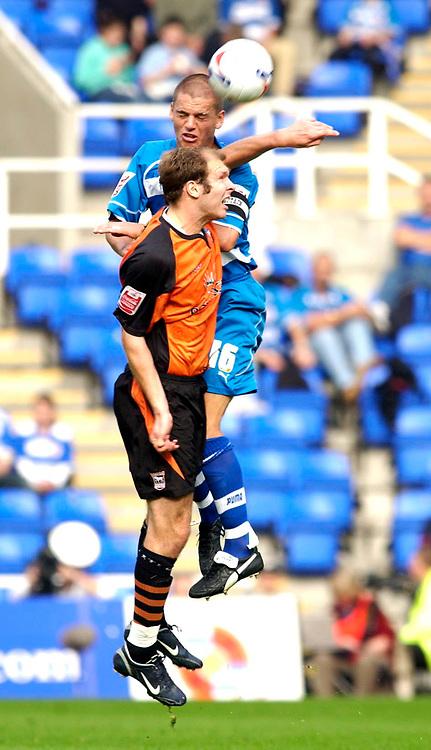 Photo: Daniel Hambury.<br />Reading v Ipswich Town. Coca Cola Championship.<br />16/10/2005.<br />Reading's Ivar Ingimarsson and Ipswich's Sam Parkin battle for the ball.