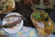 A woman prepares lunch - Communidad Siete de Augosto - Amazonas - Colombia