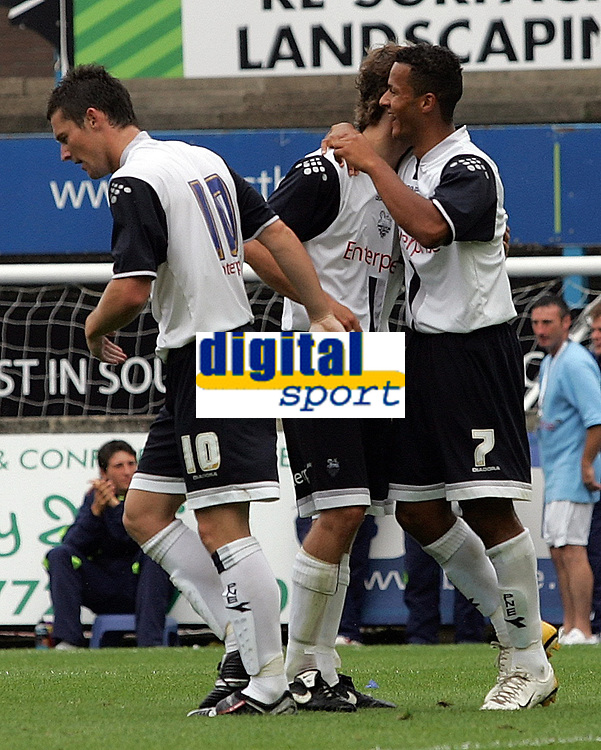 Photo: Paul Thomas.<br /> Preston North End v Manchester United. Pre Season Friendly. 29/07/2006.<br /> <br /> Preston's David Nugent and  Brain Stock celebrate with Simon Whaley (7) after he scores their second goal.