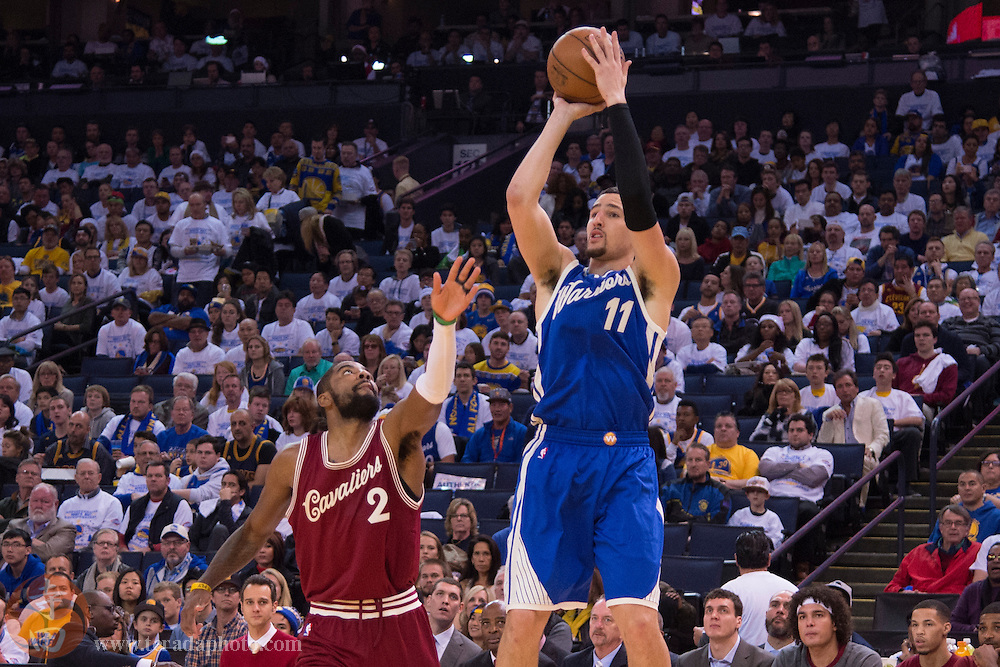 December 25, 2015; Oakland, CA, USA; Golden State Warriors guard Klay Thompson (11) shoots the basketball against Cleveland Cavaliers guard Kyrie Irving (2) in the third quarter of a NBA basketball game on Christmas at Oracle Arena. The Warriors defeated the Cavaliers 89-83.