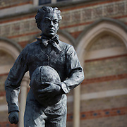 """A statue of William Webb Ellis, credited with inventing the game of rugby stands outside of Rugby School in central England, March 18, 2015.  The public school, founded in 1567 was amongst the first """"Public"""" schools in England. The school is known as the home of rugby. Local legend  states that in 1823 pupil William Webb Ellis first ran with the ball inventing the game of rugby football which took its name from the school. In 2015 20 countries will compete in the Rugby World Cup which is hosted by England REUTERS/Neil Hall"""