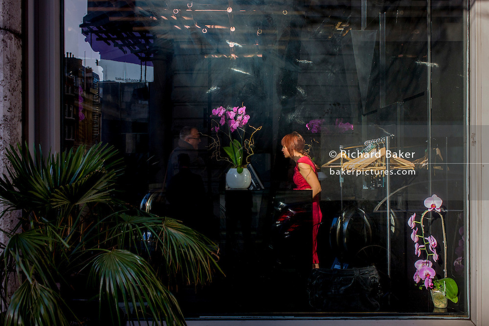 A receptionist seen through the window of a restaurant in stylish Mayfair, London.
