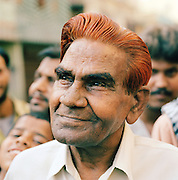 Portrait of man with henna dyed hair, Lucknow, Uttar Pradesh, India