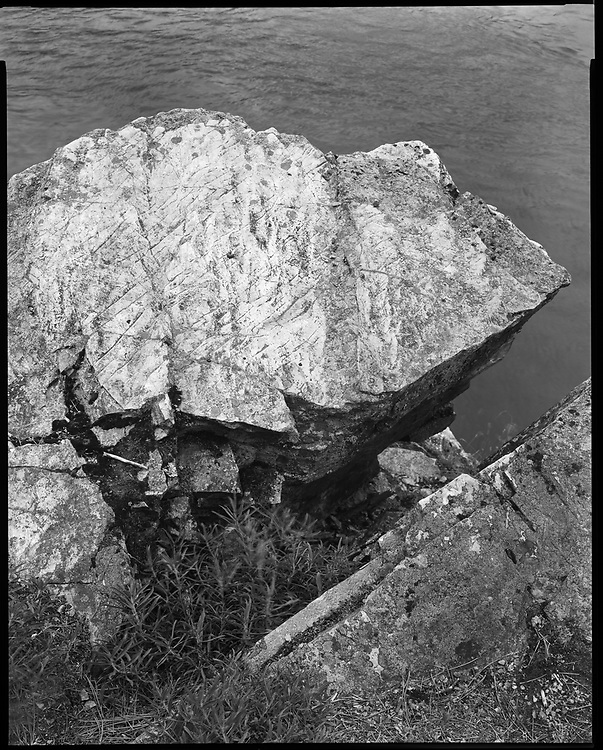 Quartzite Boulder with marks at the site of inundated Kettle Falls, Washington. Quartzite was commonly used for arrow and spear points, knives and other tools by the Native People. 2020