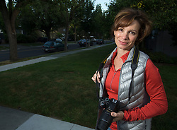 Sara Zehnder-Wallace, who runs her own film and video location scouting service, Alameda On Location, makes photographs on the street in the neighborhood near her Alameda, Calif. home, Tuesday, May 9, 2017. (Photo by D. Ross Cameron)