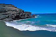 Kids playing in the surf at Green Sand Beach near South Point, The Big Island, Hawaii