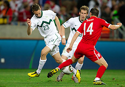 Tim Matavz of Slovenia and Valter Birsa of Slovenia vs Gareth Barry of England during the 2010 FIFA World Cup South Africa Group C Third Round match between Slovenia and England on June 23, 2010 at Nelson Mandela Bay Stadium, Port Elizabeth, South Africa.  (Photo by Vid Ponikvar / Sportida)