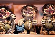 Traditional trolls on display in Tromso Gift and Souvenir Shop in Strandgata in Tromso, Norway