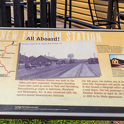 New Freedom, PA – June 25, 2016: A close up of a historical information sign at the New Freedom Train Station near PA-MD border.