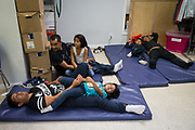 Central American asylum seekers recently released from ICE detention get ready for bed at the Catholic Charities relief center in McAllen, Texas, U.S., April 6, 2018.